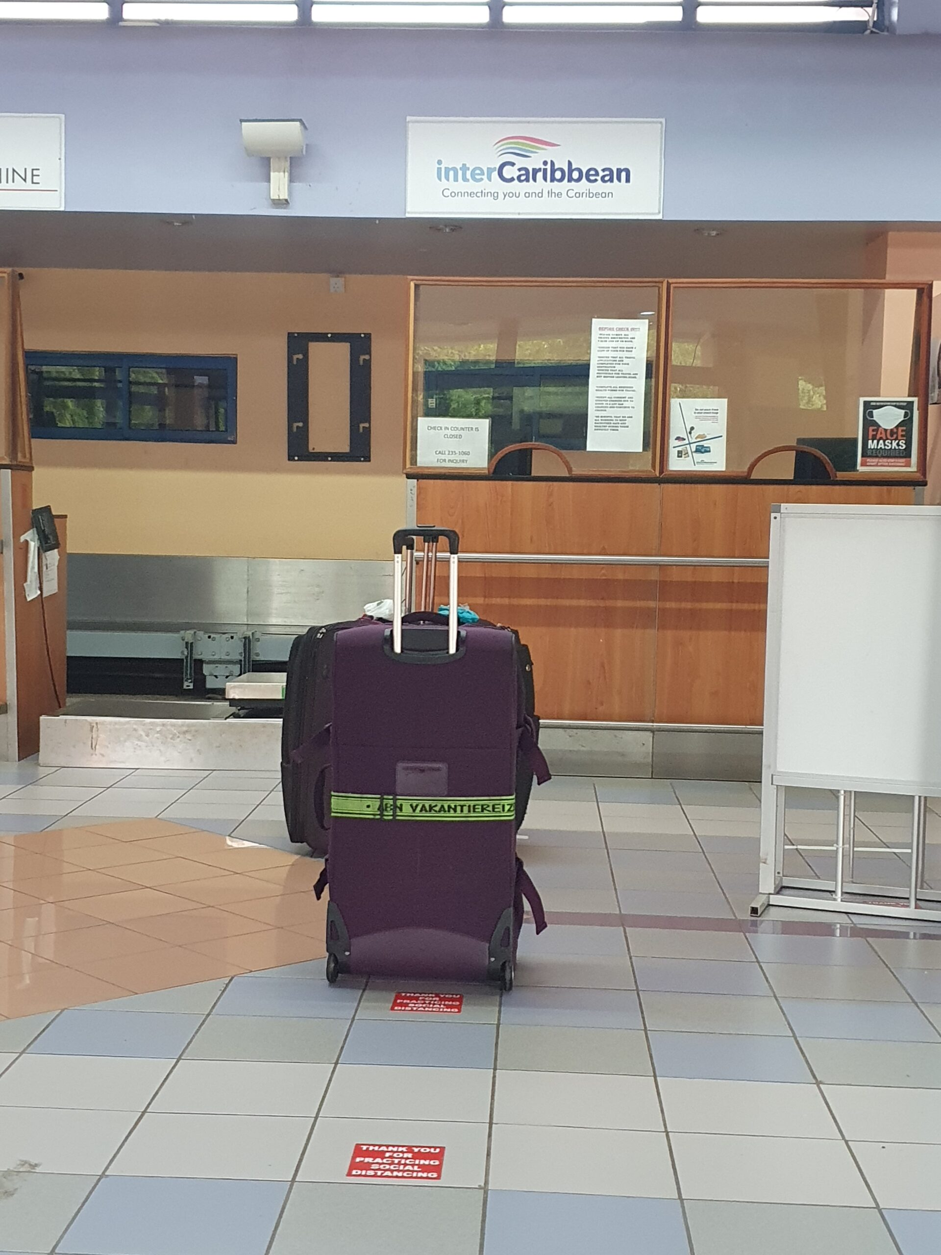 My suitcase waiting for check in.